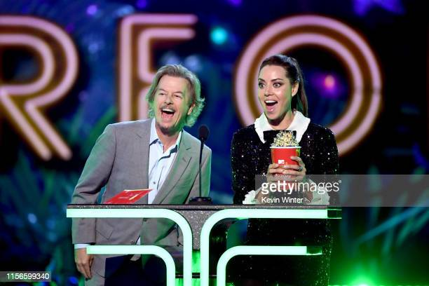 David Spade and Aubrey Plaza speak onstage during the 2019 MTV Movie and TV Awards at Barker Hangar on June 15, 2019 in Santa Monica, California.