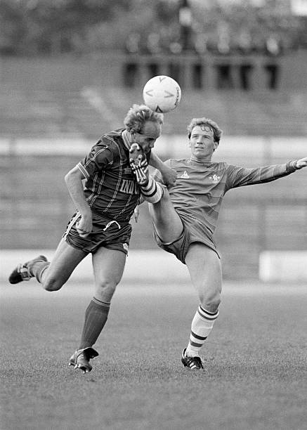 David Speedie of Chelsea tries to hook the ball away from Ian Wilson of Leicester City during the Division One match between Chelsea and Leicester...