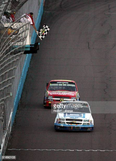 David Starr driver of the Spears Manufacturing Chevrolet crosses the finish line ahead of Jack Sprague in his Chevy Truck Chevrolet to win the NASCAR...