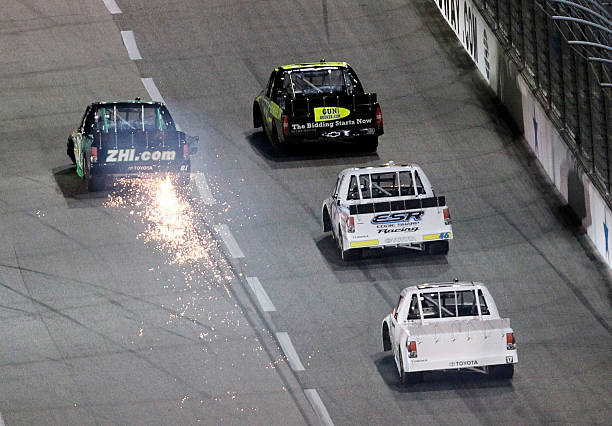 David Starr With Sparks Coming Out The Back Of His Car Goes Into
