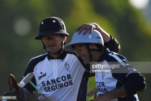 David Stirling of La Dolfina celebrates with teammate Juan Martin Nero after winning a match between La Dolfina and La Aguada as part of the HSBC...