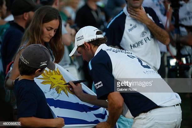 David Stirling of La Dolfina Hope Funds signs an Uruguayan flag after the final match between La Dofina Hope Funds and Ellerstina Piaget as part of...