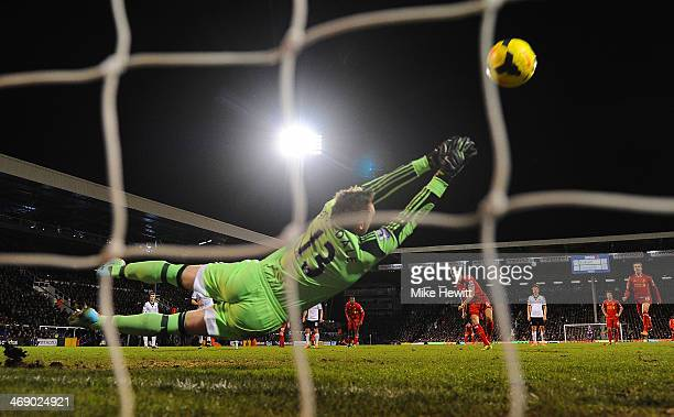 David Stockdale of Fulham dives as Steven Gerrard of Liverpool scores their third goal from the penalty spot during the Barclays Premier League match...