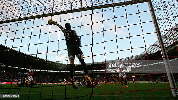 David Stockdale of Fulham saves a shot from George Boyd of Hull City during the Barclays Premier League match between Hull City and Fulham at KC...
