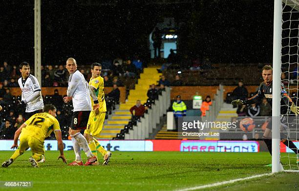 David Stockdale of Fulham watches the ball go iunto his own net as Shaun Miller of Sheffield United scores the winning goal in extra time during the...
