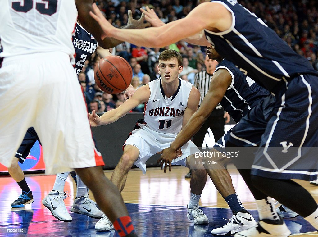 David Stockton #11 of the Gonzaga Bulldogs passes the ball in traffic against the Brigham Young Cougars during the championship game of the West Coast Conference Basketball tournament at the Orleans Arena on March 11, 2014 in Las Vegas, Nevada. Gonzaga won 75-64.