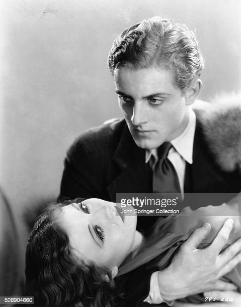David Stone holds Hallie Hobart in his arms in a scene from the 1930 romance The Devil's Holiday