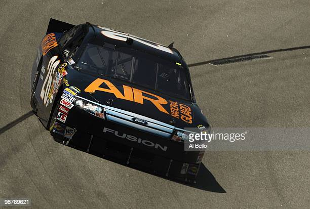 David Stremme driver of the Air National Guard Ford drives during practice for the Sprint Cup Series CROWN ROYAL Presents the Heath Calhoun 400 at...
