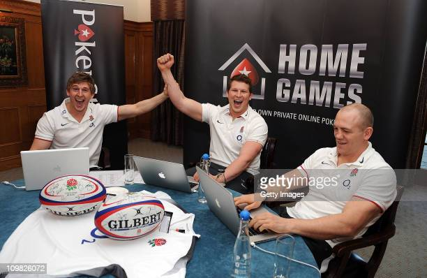 David Strettle and Dylan Hartley celebrate winning a hand with Mike Tindall during the PokerStars England Rugby Challenge at Pennyhill Park on 7...