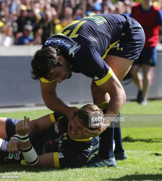 David Strettle of Clermont Auvergne is congratulated by team mate Remi Lamerat after scoring their second try during the European Rugby Champions Cup...