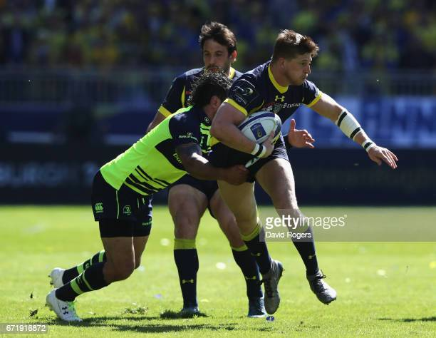 David Strettle of Clermont Auvergne is tackled by Isa Nacewa during the European Rugby Champions Cup semi final match between ASM Clermont Auvergne...