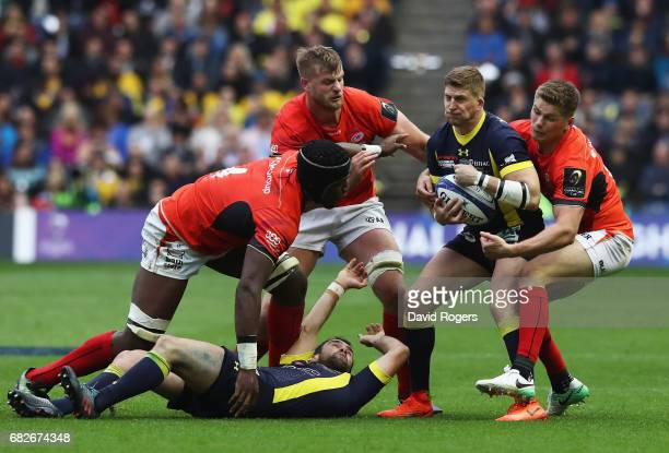 David Strettle of Clermont Auvergne is tackled by Owen Farrell of Saracens during the European Rugby Champions Cup Final between ASM Clermont...