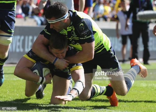 David Strettle of Clermont Auvergne scores their second try despite being held by Fergus McFadden during the European Rugby Champions Cup semi final...