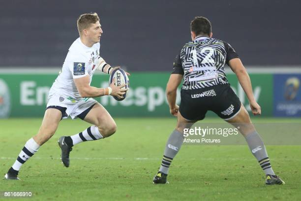 David Strettle of Clermont is marked by Owen Watkin of Ospreys during the Champions Cup Round 1 match between Ospreys and Clermont at The Liberty...