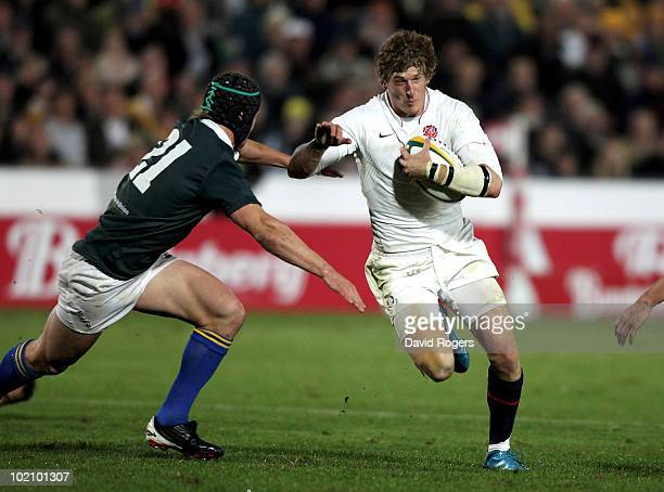 David Strettle of England takes on Berrick Barnes during the match between the Australian Barbarians and England at on June 15 2010 in Gosford...