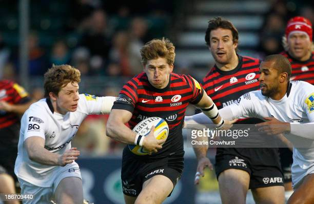 David Strettle of Saracens attacks during the Aviva Premiership match between Saracens and Newcastle Falcons at Allianz Park on November 03 2013 in...