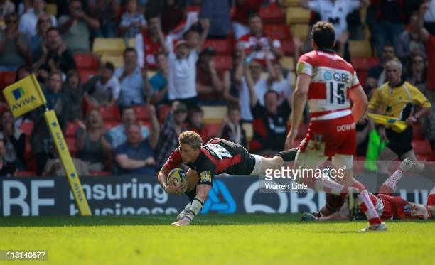 David Strettle of Saracens dives to score the fourth bonus try during the Aviva Premiership match between Saracens and Gloucester on April 24 2011 in...