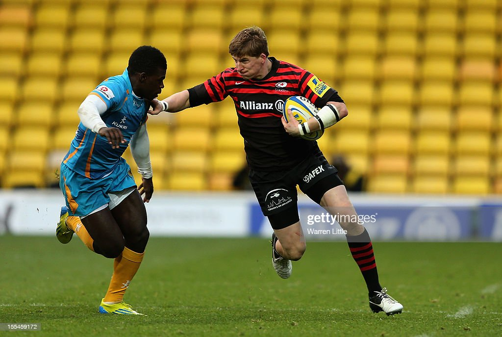 David Strettle of Saracens hands off Christian Wade of Wasps during the Aviva Premiership match between Saracens and London Wasps at Vicarage Road on November 4, 2012 in Watford, England.