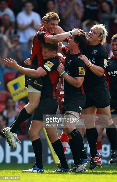 David Strettle of Saracens is congratulated by his team mates after scoring the fourth bonus try during the Aviva Premiership match between Saracens...