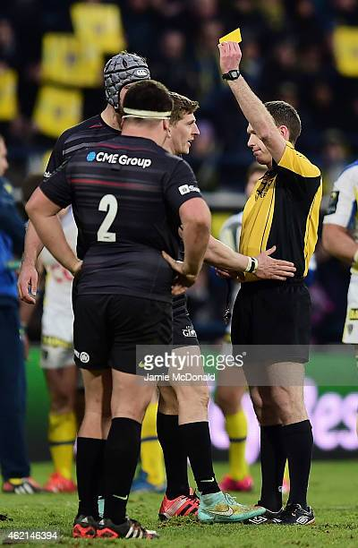 David Strettle of Saracens is shown the yellow card by Referee George Clancy during the European Rugby Champions Cup Pool 1 match between Clermont...
