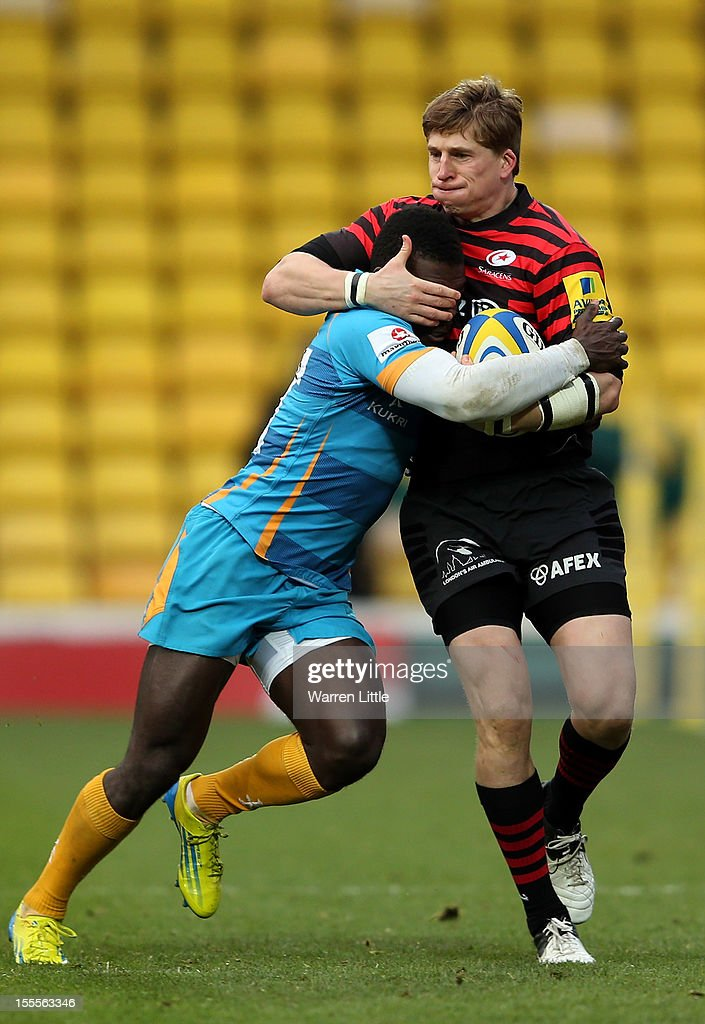 David Strettle of Saracens is tackled by Christian Wade of London Wasps during the Aviva Premiership match between Saracens and London Wasps at Vicarage Road on November 4, 2012 in Watford, England.