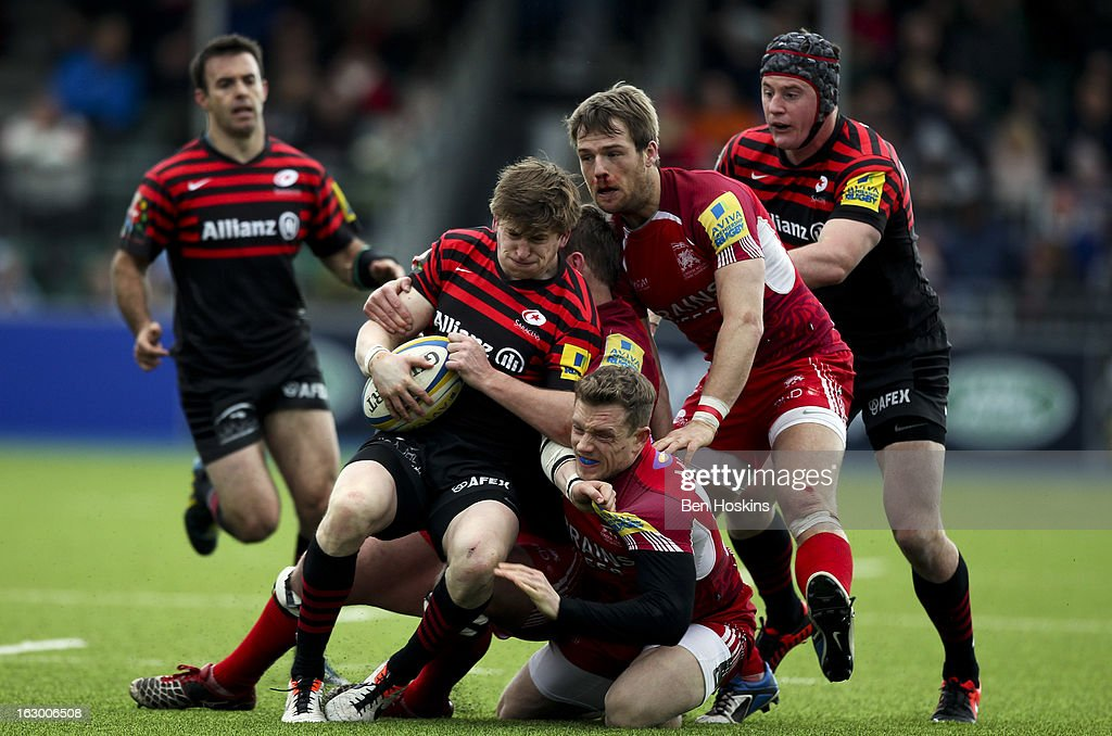 David Strettle of Saracens is tackled during the Aviva Premiership match between Saracens and London Welsh at Allianz Park on March 03, 2013 in Barnet, England.