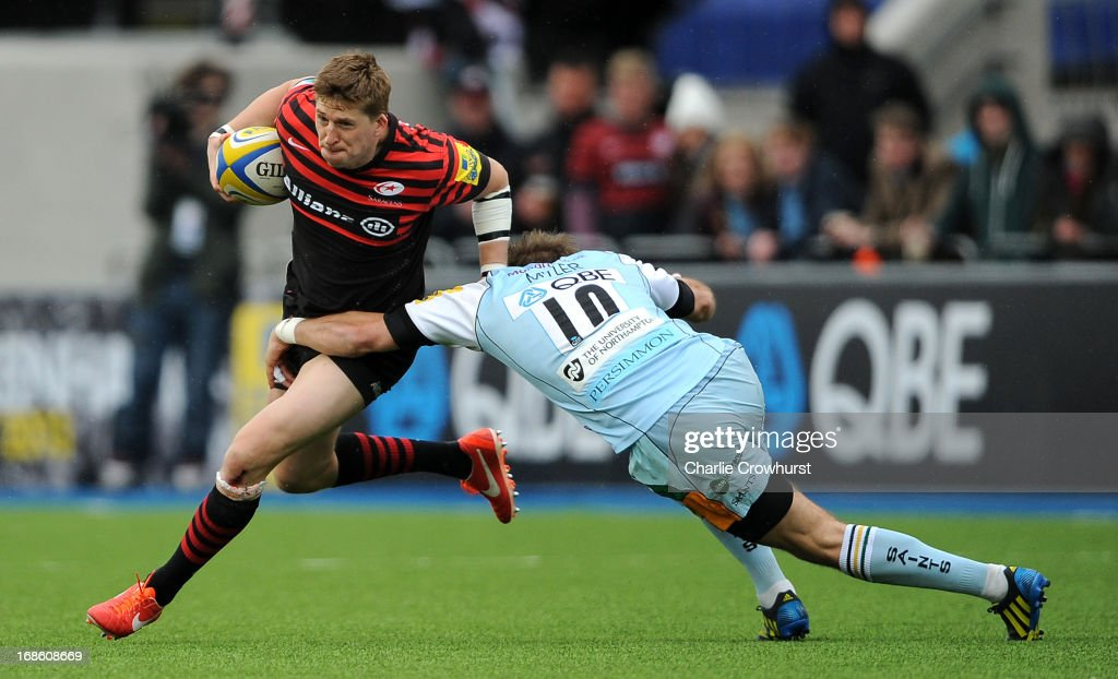 David Strettle of Saracens looks to get passed Northampton's Stephen Myler during the Aviva Premiership Semi Final match between Saracens and Northampton Saints at Allianz Park on May 12, 2013 in London, England.