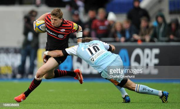 David Strettle of Saracens looks to get passed Northampton's Stephen Myler during the Aviva Premiership Semi Final match between Saracens and...