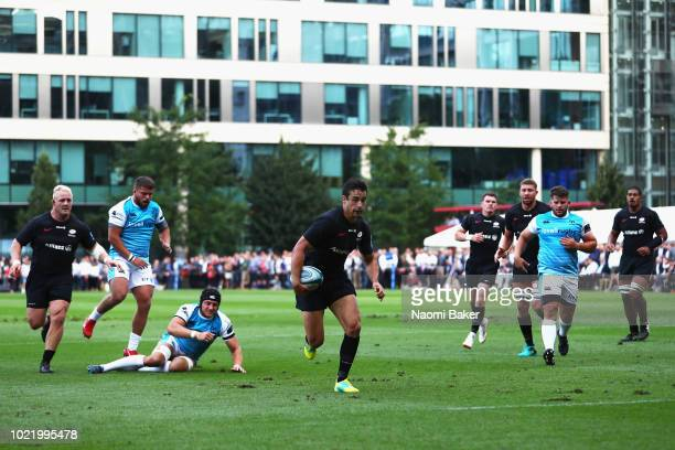 David Strettle of Saracens makes a break which leads to him scoring a try during the match between Saracens and Ospreys at Honourable Artillery...