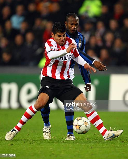 David Suazo of Inter Milan tries to tackle Carlos Salcido of PSV Eindhoven during the UEFA Champions League Group G match between PSV Einhoven and...