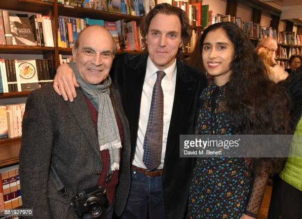 David Suchet Alexander Newley and Sheila Raman attend the launch of new book 'Unaccompanied Minor' by Alexander Newley at Daunt Books on November 29...