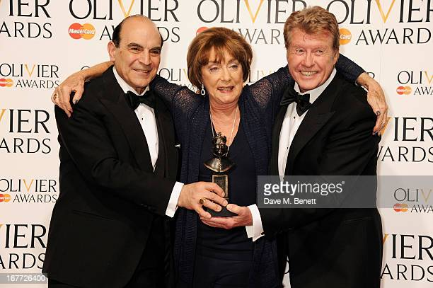 David Suchet, Gillian Lynne, winner of the Special Award, and Michael Crawford pose in the press room at The Laurence Olivier Awards 2013 at The...