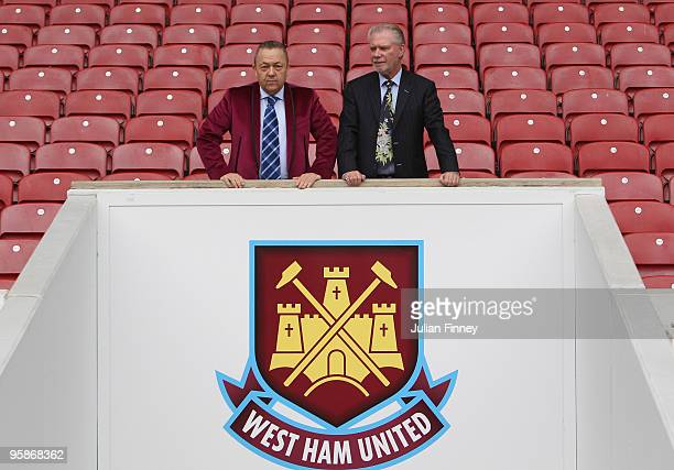 David Sullivan and David Gold pose for a photo as they are announced as new joint chairmen of West Ham United during a photocall at Upton Park on...