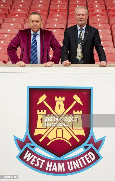 David Sullivan and David Gold pose for pictures at Upton Park following the announcement of their joint takeover of West Ham United Football Club in...
