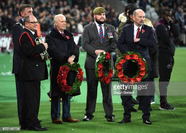 David Sullivan participates for a minute's silence ahead of Remembrance Sunday prior during the Premier League match between West Ham United and...