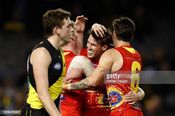 David Swallow of the Suns celebrates a goal during the round 16 AFL match between the Gold Coast Suns and the Richmond Tigers at Marvel Stadium on...
