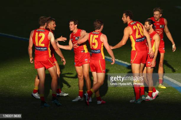 David Swallow of the Suns celebrates a goal during the round nine AFL match between Gold Coast Suns and the Greater Western Sydney Giants at Metricon...