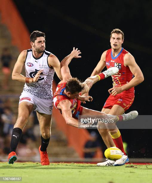 David Swallow of the Suns competes for the ball during the round 13 AFL match between the Gold Coast Suns and the Carlton Blues at TIO Stadium on...