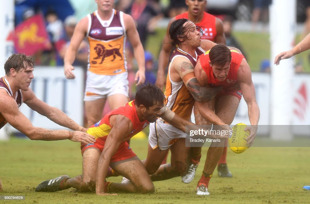David Swallow of the Suns is pressured by the defence during the JLT Community Series AFL match between the Gold Coast Suns and the Brisbane Lions at Fankhauser Reserve on March 11, 2018 in Brisbane, Australia.