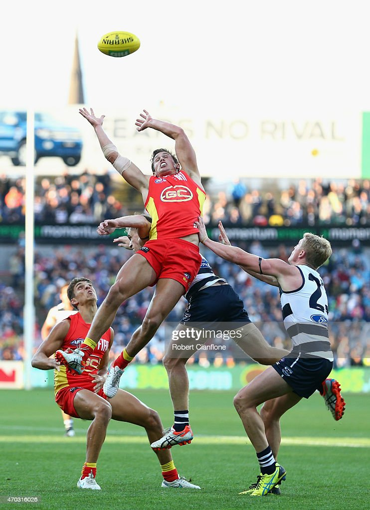David Swallow of the Suns leaps for the ball during the round three AFL match between the Geelong Cats and the Gold Coast Suns at Simonds Stadium on April 19, 2015 in Geelong, Australia.