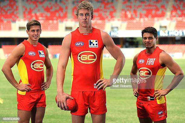 David Swallow Tom Lynch and Dion Prestia pose for a photograh during a Gold Coast Suns AFL media session at Metricon Stadium on January 29 2014 on...