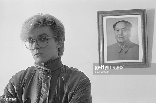 David Sylvian from English band Japan posed standing in front of a portrait of Chairman Mao during the Tin Drum sessions in London in September 1981