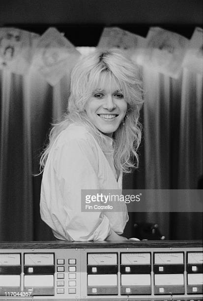 David Sylvian singer with British New Wave band Japan smiling as he poses behind recording equipment in Morgan Studios a recording studio in...