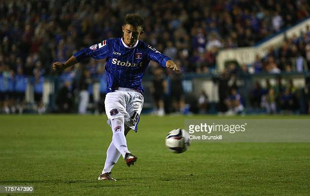 David Symington of Carlisle United scores the winning goal in the penalty shoot out during the Capital One Cup first round match between Carlisle...