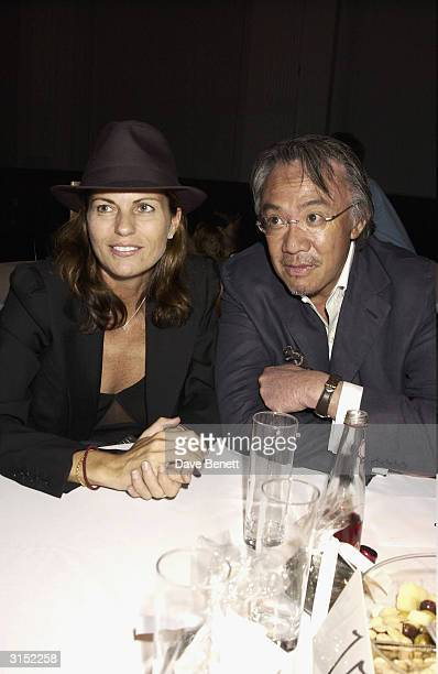 David Tang and wife Lucy and Annabel Nielsen attend the Frost French Fashion Show 2003 at the Royal Horticultural Hall on September 23 2003 in London