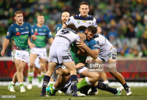 David Taylor of the Raiders is tackled during the round 17 NRL match between the Canberra Raiders and the North Queensland Cowboys at GIO Stadium on...