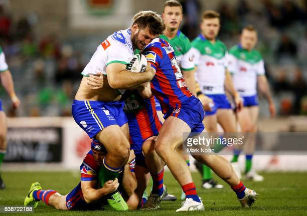 David Taylor of the Raiders is tackled during the round 25 NRL match between the Canberra Raiders and the Newcastle Knights at GIO Stadium on August...
