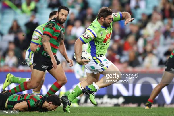 David Taylor of the Raiders runs the ball during the round 21 NRL match between the South Sydney Rabbitohs and the Canberra Raiders at ANZ Stadium on...