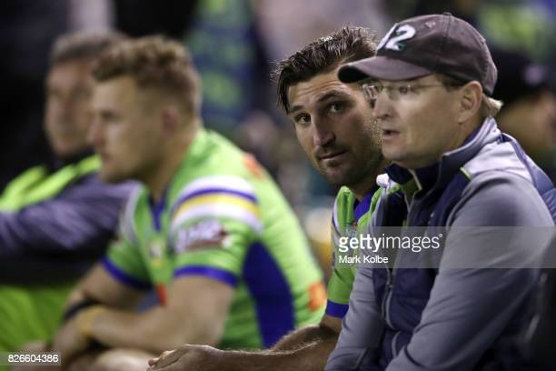 David Taylor of the Raiders watches on from the bench during the round 22 NRL match between the Cronulla Sharks and the Canberra Raiders at Southern...