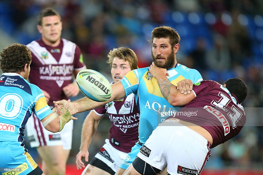 David Taylor of the Titans offloads during the round 18 NRL match between the Gold Coast Titans and the Manly Sea Eagles at Cbus Super Stadium on July 13, 2015 in Gold Coast, Australia.
